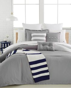 Simple and modern, this Lacoste comforter and duvet set creates a look that effortlessly blends classic & preppy styles.