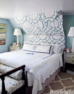 disguised the sloped ceiling in the master bedroom with a half canopy, which creates both height and drama - depending on how far you want to go with this