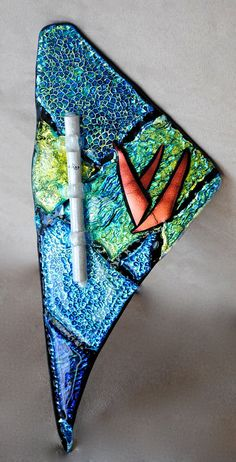 This beautiful Multi-Colored Fused Glass Mezuzah case was created in my Miami Beach Studio. It serves as a mezuzah case and a wall sculpture! Fused Glass Art, Dichroic Glass, Bar Mitzvah, Hebrew Sayings, Trish Regan, Menorah, Wall Sculptures, Miami Beach, Wearable Art