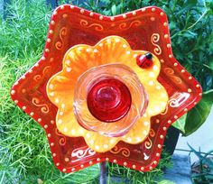 Items similar to Garden Decor Glass Plate Flower For Your Winter or Spring Garden in a Red and Yellow Star on Etsy