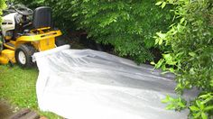 tarp tow system attaches to your riding lawn mower or zero turn to move or pull all your leaves, mulch, tree branches, limbs, and bush trimmings while using a tarp to do all the work for you.