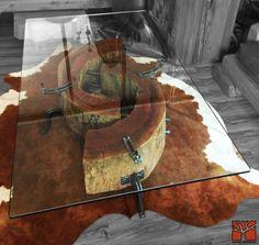"""Nativo Red Wood. Mesa de centro linea """"Natural Wood"""" con troncos reciclados de una pieza de Roble Rústico con corteza con soportes originales de fierro forjado y cubierta de cristal de 0.90x1.40x15 mm espesor, sobre cuero natural de vacuno cafe con blanco. www.facebook.com/nativoredwoodsa"""