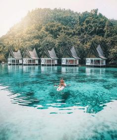 Not sure where this is but i could live like this! Paradise. Clear waters. Kayak. Paddle board.