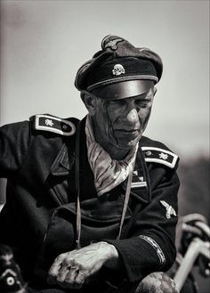 A German Tank Commander.....the strain of battle is very apparent on his face.