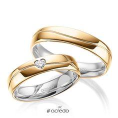Alianzas de boda con diamante en forma de corazón