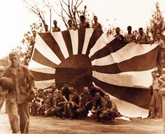 Battle of Saipan, Jun-Jul 1944. Large Japanese flag captured by U.S. Forces on Saipan, July 9th. Photographed by USS Indianapolis (CA 35) photographer. U.S. Navy photograph, now in the collections of the National Archives.