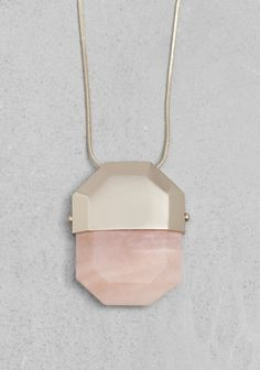 & OTHER STORIES A brass necklace featuring a chunky, angular pendant.