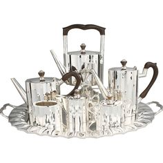 Art Deco Substantial Sterling Coffee and Tea Set  Mexico  1930's  This is a beautiful, substantial and well designed set. The feel is heavy and luxurious. It consists of an under tray, tea pot, coffee pot, hot water pot with warmer, sugar, creamer and of course the waste pot.