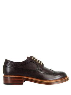 Grenson – Sid, mens long wing brogues in burgundy grain leather with a burnished finish and bespoke punched design. The shoes are Goodyear welted with a stacked wooden heel, polished leather sole and red leather Grenson embossed insole.    Grenson - Made in England since 1866