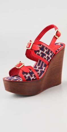 Tory Burch wedge sandals in red and blue.