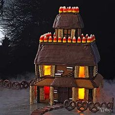 Gather your favorite trick-or-treat candies and some icing to create a spooky Halloween gingerbread house.