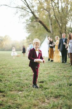 The ring bearer, Dash, wore a maroon velvet suit by Appaman.