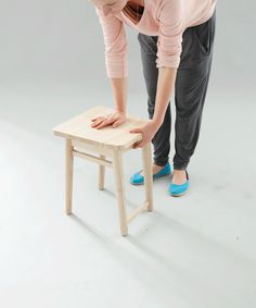 Stool becomes a chair, with pop-up backrest /  saves storage space / by designer Marta Morawska