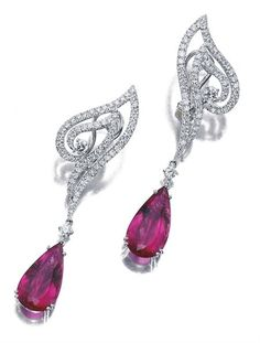Pair of Diamond and Rubellite Pendant-Earrings   18 kt. white gold, topped by stylized ribbons set with 130 round diamonds, accented and joined by 4 round diamonds, altogether approximately 2.00 cts., suspending 2 pear-shaped rubellites approximately 11.30 cts., approximately 9 dwt.