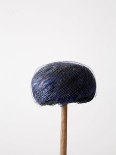 circa late 1950s - early 1960s Richly toned, blue bird feathers sweep around this vintage pillbox hat. The classically shaped hat features blue netting to keep the feathers. - vibrant blue bird feathe