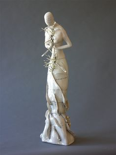 Jocelyn Braxton Armstrong Ceramics  porcelain, black slip, linen paper