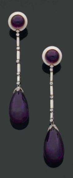 CARTIER - A rare pair of Art Deco platinum, gold, enamel, amethyst and diamond earrings, circa 1920. Length 8.2cm. Signed. #Cartier #ArtDeco #earrings