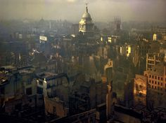 """A view of London after a German air raid, 1940. """"The Guildhall was smitten by fire and blast,"""" Churchill recalled almost a decade later, in 1949, """"and St. Paul's Cathedral was only saved by heroic exertions. A void of ruin at the very center of the British world gapes upon us to this day. But when the King and Queen visited the scene they were received with enthusiasm far exceeding any Royal festival."""""""