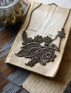 i love these necklaces from white owl on etsy. http://www.etsy.com/shop/whiteowl