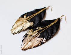 Leather Feather Earrings - Black Leather Dipped in Gold - Black Raven Feather Jewellery. $30.00, via Etsy.