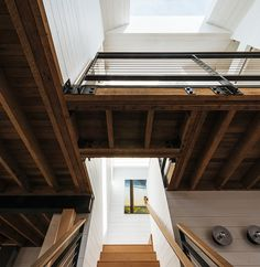 """Typically in close city lots, all the light comes from the front and back of the house, so that the center becomes a dark spot,"" Curtiss said, explaining her decision to install a Velux skylight above the staircase. ""[It brought] a glow to the center of the house."" On the floor beneath it, she cut a hole that ushers in daylight to the lower regions of the house. It also creates a bridge separating the master bedroom from the two smaller rooms."