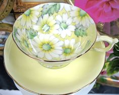 paragon chintz, lovely soft yellow with flowers only inside the cup...more reason to drink up