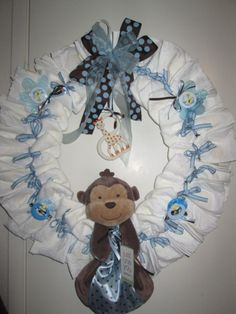 Diaper Wreaths | Diaper Wreath for a Baby Boy Baby Shower - Blue Animal Themed Diaper ... by sophia