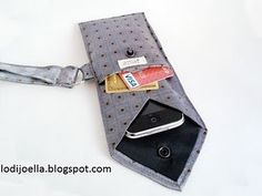 Could also be an glasses case. Great way to use Dad's old ties. - Keep your iPhone or Blackberry or similarly sized electronic device free from scratches in this unique case made from a … Tie Crafts, Sewing Crafts, Sewing Projects, Craft Projects, Diy And Crafts, Maxi Floral, Old Ties, Crochet Phone Cases, Diy Sac