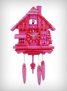 Retro style meets space age materials in this modern take on the classic German design. This fun pink plastic Cuckoo Clock is sooo kitsch and cute! The little birdie at the top, and the pendulum at the bottom both move back and forth with the second hand. It is the perfect addition to any retro or eclectic decor