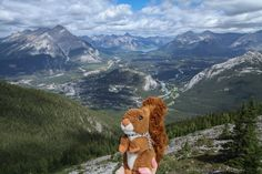 https://flic.kr/p/xHxqmG   Banff    Second only to Peyto Lake, here is Dexter's favourite view of the Rockies. This is the town of Banff and the surrounding mountains, viewed from the top of Sulphur Mountain. Dexter hiked up there, mind you, he is not a lazy squirrel taking the gondola :-) #mascot #mascotte #travelingmascot #travellingmascot #DexterLEcureuil #DexterTheSquirrel #peluche #stuffedanimal #Canada