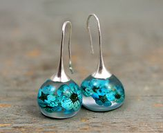 New: Real blossom earrings. Turquoise real flowers in resin spheres. Silver ox earwires. Big earrings. Gift for her.