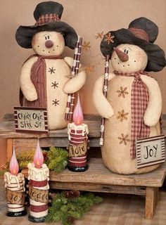 Salt Pepper Snowmen -Upcycled from a set of wooden salt pepper grinders, these snowmen have a charm all of their own.