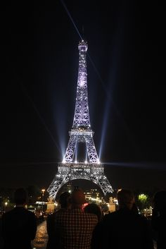 The Eiffel Tower lights up in the honor of Paris Fashion Week 2016.