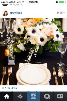 Anemone + pale pink + white against a dark navy linen. Looks fab!