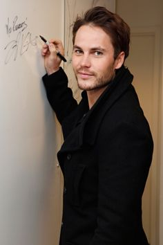 """Dude.     Taylor Kitsch signs his name with """"No Regrets!""""     So he's basically become Tim Riggins, right?"""