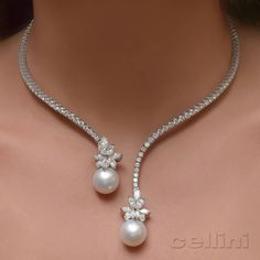 Lovely necklace of pearls and diamonds                                                                                                                                                                                 More