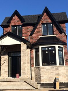 Best Our Brick With Weathered Wood Roof Bronze Gutters Cream 400 x 300