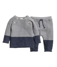 Check this out! BABY EXCLUSIVE/CONSCIOUS. Set with garter-stitched sweater and pants in organic cotton. Sweater with buttons at top and long raglan sleeves with rolled edges at cuffs. Pants with an elasticized drawstring waistband and roll-edge hems. - Visit hm.com to see more.