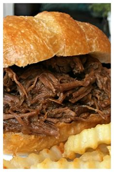BEST-EVER SLOW COOKER BBQ BEEF SANDWICHES - Fantastic, easy to make barbecue beef recipe is made with a chuck roast that's slow cooked in a homemade tangy, zesty sauce. Minutes to whip together, allowing your slow cooker to do most of the work, delivering Grill Sandwich, Hot Beef Sandwiches, Roast Beef Sandwich, Chicken Sandwich, Sandwich Recipes, Slow Cooking, Slow Cooked Meals, Cooking Ideas, Cooking Oil