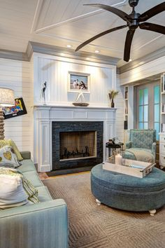 Living Room with Tiled Fireplace, Large Ceiling Fan and Coastal Accents