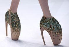 Alexander McQueen- would never wear these- just reminded me of those shoes we saw at the shoe gallery @Lexie Tompkins Craziness lol