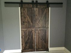 There are basically two types of barn door hardware. The first is a rustic, flat track sliding door system The second is a more modern roller and track style Old Barn Doors, Barn Doors For Sale, Rustic Doors, Wood Doors, Rustic Barn, Barn Door Designs, Barn Door Track, Sliding Barn Door Hardware, Sliding Doors