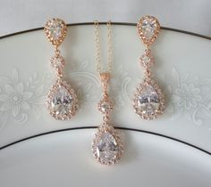 Crystal Bridal Earrings, Bridal Jewelry SET - Available in Silver, Rose Gold or Gold setting  Red carpet elegance! This beautiful bridal set has pear shaped Swarovski crystals surrounded by a halo of smaller cut crystals set in a soft rose gold or silver setting. The Rosaline set is a vintage inspired necklace and earring set that will look stunning on your wedding day! - Total length of earring is 1 3/4 - Pendant drop is 1.50  * Refunds and Exchanges - I offer a 100% money-back guarantee or…