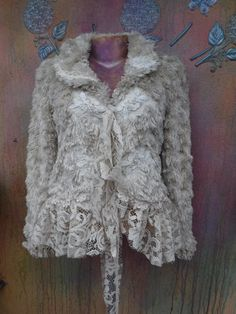 fluffy coat, fur jacket, rock chic jacket, bohemian jacket, short jacket, crop jacket, mori girl, hippy coat, shabby jacket, gothic, shes a bohemian rock chic fluffy jacket in ivory hues kissed with ruffles of rugged lace,butterflies and bridal decals adding to her charm!! a cropped more fitted jacket she will suit a medium to 38 bust.. sleeves are 31 long from neck down and length is 25 from top of shoulders down.. looks great worn casually over old denims or dressed to thrill layered…