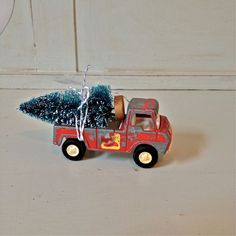 Toy Truck Hauling Bottle Brush Tree by VintageJunkyStyle on Etsy, $12.00