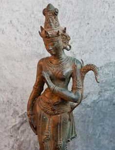 Bronze Balinese Dewi Statue  Elegant cast bronze of the goddess Dewi Sri. $225.
