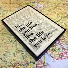 Inspirational quote typographic altered book art in wooden