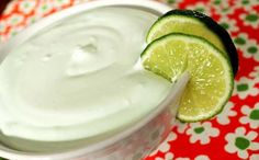 Easy Margarita Fruit Dip Recipe 1 (8 ounce) package light cream cheese, softened 1/3 cup non-alcoholic liquid margarita mix 2 drops green food coloring, optional 1-1/2 cups light whipped topping Lime wedges for decoration