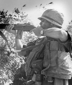 """Operation Utah–Marine from F Company, 2nd Battalion, 7th Marines, gets into a firing position and engages in a fire fight with the Viet Cong, just after being lifted to the position by helicopter."""" (4 Mar 1966) ~ Vietnam War"""