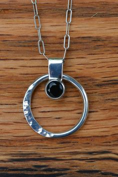 Sterling Silver Hammered Circle Pendant with Black Spinel via Etsy